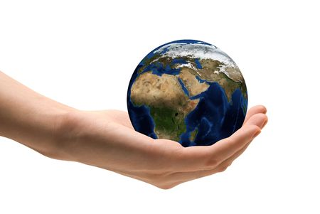 Take care the earth concept. Human hand holding the world in hands.  photo
