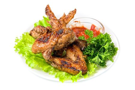 fried chicken wings with vegetables and sauce