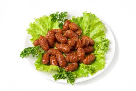 grilled sausages: grilled sausages on green lettuce with isolated on white  Stock Photo