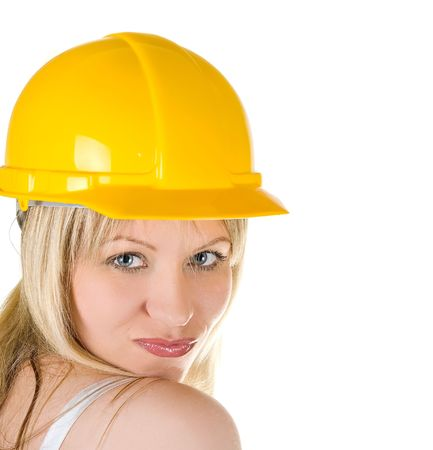 pretty woman in yellow building helmet isolated on white  photo