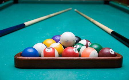 billiards halls: The Pool Billiard balls on a green table  Stock Photo
