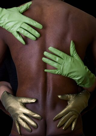 Two girl hands embrace black man at gloves on white Stock Photo - 5805195