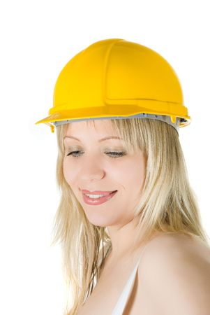 Beauty woman in yellow building helmet isolated on white photo