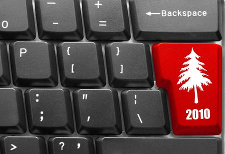 Close-up of computer keyboard with red Christmas tree key photo