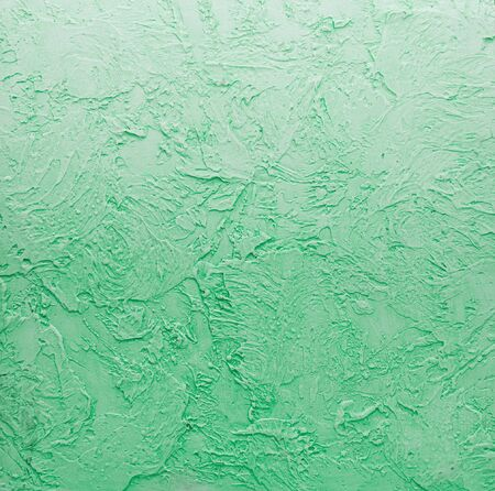 Grunge green stone wall can be used as background for design photo