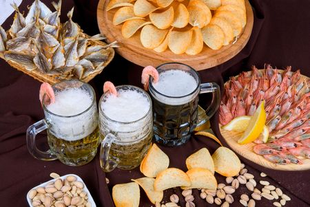 Beer and snacks set: chips, pistachio, shrimp and fish Stock Photo - 5964441