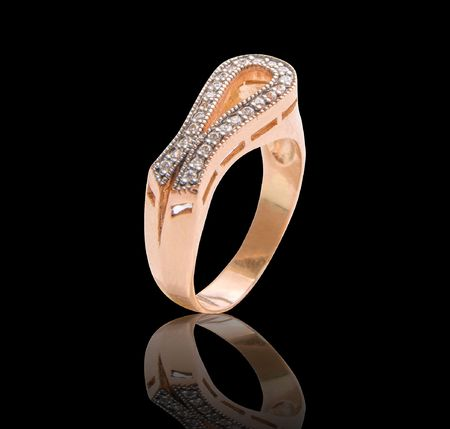 Beauty gold ring with diamond gems on black photo