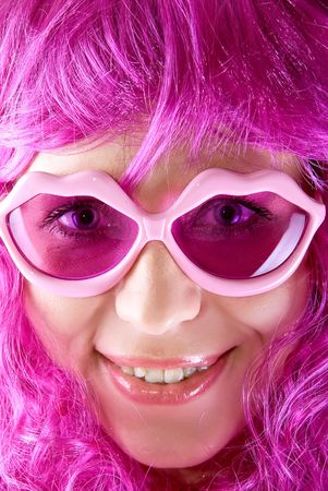 Photo of a pink girl closeup portrait with lips shaped glasses photo