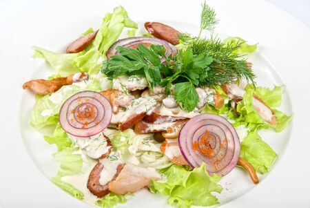Tasty salad dish close up with sausage and vegetables on a white background photo