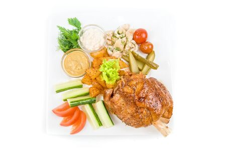Tasty pork dish with vegetables on a white background photo