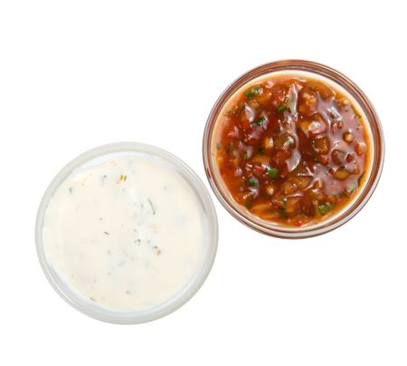 dirty dishes: White and red sauces isolated on a white background