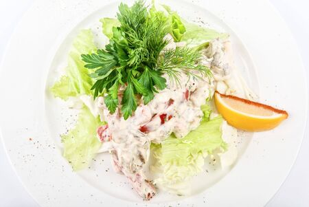 Tasty salad of seafood and vegetable close up on a white background photo