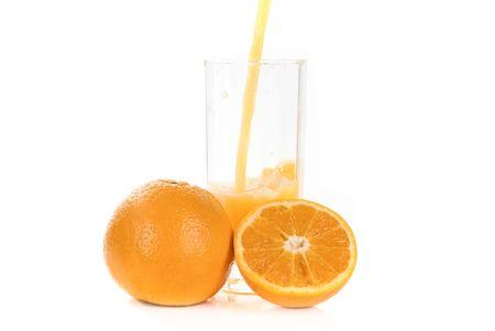 Fresh pouring orange juice with fruits isolated on a white background  photo