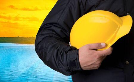 Builder on beauty sunset on lake, and orange sky photo