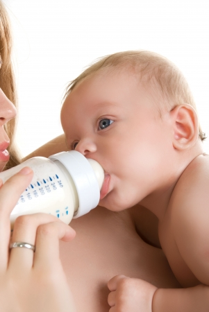 Mother give drink her baby boy by feeding bottle Stock Photo - 6274677
