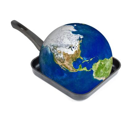 Global warming concept. Earth at the frying pan isolated on white photo