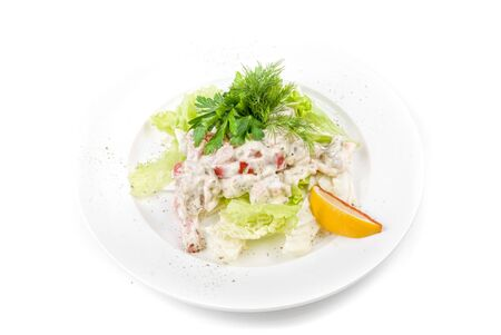 Tasty salad of seafood and vegetable dish close up on a white background photo