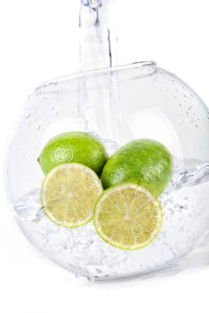 Green limes in water dropped isolated on a white photo
