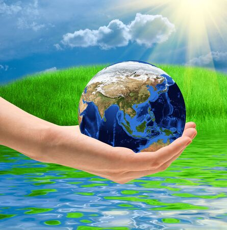Take care the world concept on a summer nature background Stock Photo - 6320362