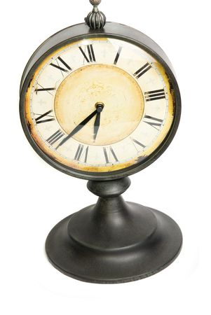 An old vintage clock isolated on a white background photo