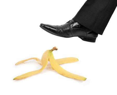 Business risk concept: boot to step on a banana skin Stock Photo - 6449602