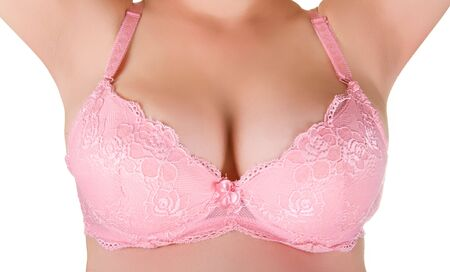 sexy breast: pink lingerie at woman breast closeup isolated on white