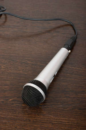 The microphone on a brown wooden background photo