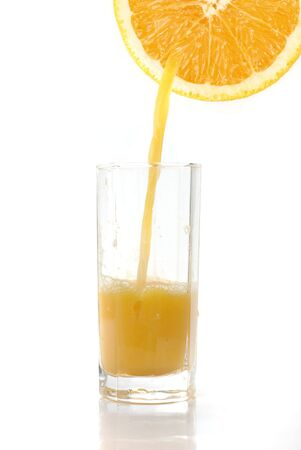 Fresh squeezed orange juice isolated on a white background photo