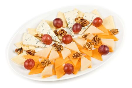different cheese with grapes isolated on a white photo