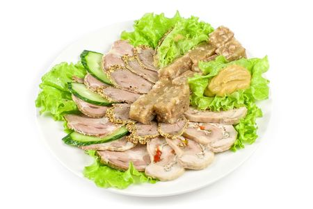 jellied minced meat and meat cuts on green salad photo