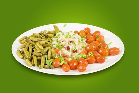 Marinated vegetables at the plate on a green background photo