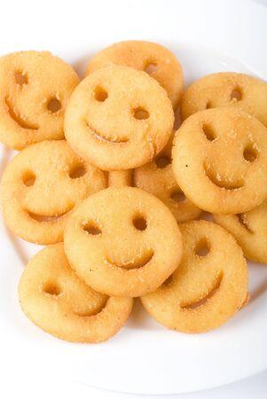 fried potato as smile shape isolated on a white photo