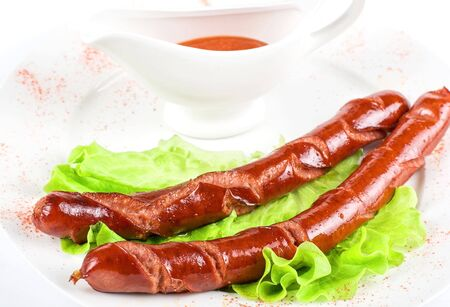 grilled sausage closeup with lettuce and red sauce Stock Photo - 6673706