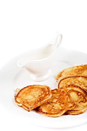 thick pancake with sauce on a white Stock Photo - 6673690