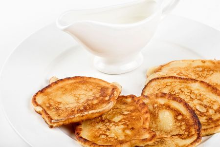 thick pancake closeup with sauce on a white Stock Photo - 6673673