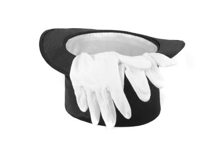 Black magic hat and white gloves isolated on a white background photo