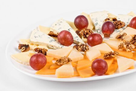 different cheese and grapes and nuts close up composition photo