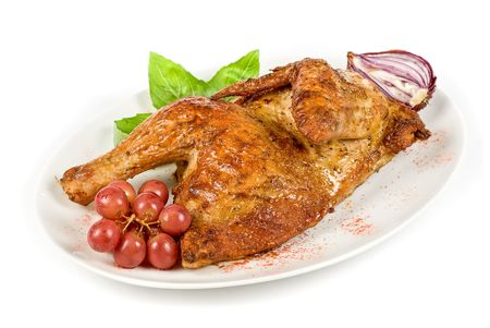 Half roasted chicken with grape on a white photo