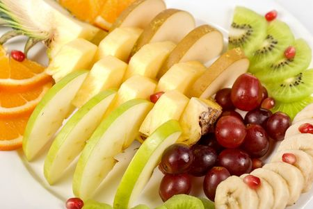 Fruit assortment closeup at plate on a white background photo