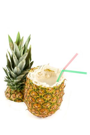 Milk cocktail with pineapple as cup on a white photo