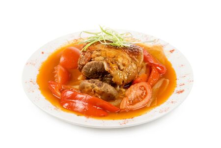 knuckle of veal with vegetables isolated on a white photo