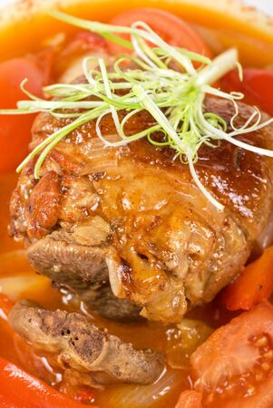 knuckle of veal baked with vegetables closeup photo