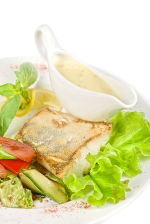 Tasty fish pike perch with mix of vegetables photo