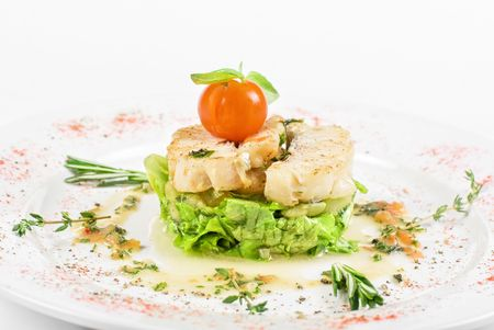 Salad of roasted filet halibut at lime sauce with courgette and aubergine, and cherry tomato. photo