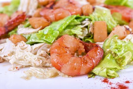 Salad with shrimps and vegetable close up photo