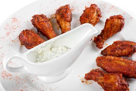 chicken wings with sauce closeup at white plate photo