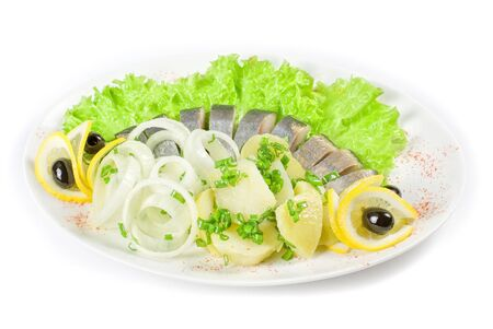 Herring with potato and vegetables isolated on a white background photo