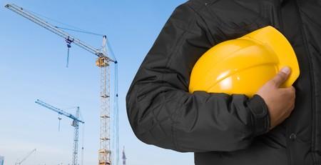 crane tower: building panorama with builder closeup