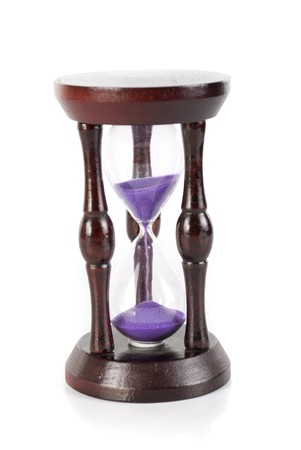 hourglass closeup isolated on a white background photo