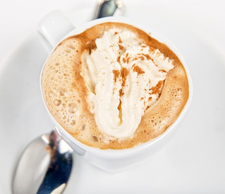 espresso coffee cup with whipped cream and,cinnamon photo